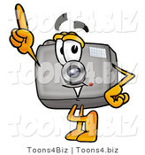Illustration of a Cartoon Camera Mascot Pointing Upwards by Toons4Biz