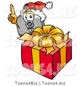 Illustration of a Cartoon Camera Mascot Standing by a Christmas Present by Toons4Biz