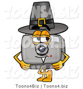 Illustration of a Cartoon Camera Mascot Wearing a Pilgrim Hat on Thanksgiving by Toons4Biz