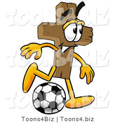 Illustration of a Cartoon Christian Cross Mascot Kicking a Soccer Ball by Toons4Biz