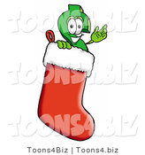 Illustration of a Cartoon Dollar Sign Mascot Wearing a Santa Hat Inside a Red Christmas Stocking by Toons4Biz