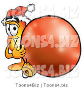 Illustration of a Cartoon Fire Droplet Mascot Wearing a Santa Hat, Standing with a Christmas Bauble by Toons4Biz