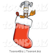 Illustration of a Cartoon Hammer Mascot Inside a Red Christmas Stocking by Toons4Biz