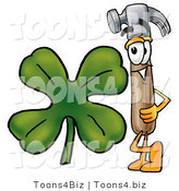 Illustration of a Cartoon Hammer Mascot with a Green Four Leaf Clover on St Paddy's or St Patricks Day by Toons4Biz