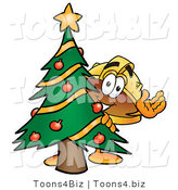 Illustration of a Cartoon Hard Hat Mascot Waving and Standing by a Decorated Christmas Tree by Toons4Biz