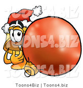 Illustration of a Cartoon Hard Hat Mascot Wearing a Santa Hat, Standing with a Christmas Bauble by Toons4Biz