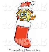 Illustration of a Cartoon House Mascot Wearing a Santa Hat Inside a Red Christmas Stocking by Toons4Biz