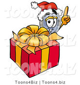 Illustration of a Cartoon Magnifying Glass Mascot Standing by a Christmas Present by Toons4Biz