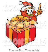 Illustration of a Red Cartoon Telephone Mascot Standing by a Christmas Present by Toons4Biz