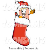 Illustration of an Adhesive Bandage Mascot Wearing a Santa Hat Inside a Red Christmas Stocking by Toons4Biz