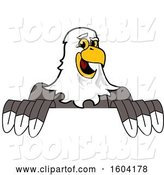 Vector Illustration of a Cartoon Bald Eagle Mascot over a Sign by Toons4Biz