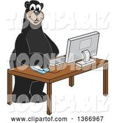 Vector Illustration of a Cartoon Black Bear School Mascot Using a Desktop Computer by Toons4Biz