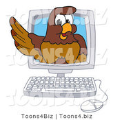 Vector Illustration of a Cartoon Falcon Mascot Character in a Computer by Toons4Biz