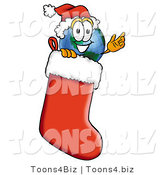 Vector Illustration of a Cartoon Globe Mascot Wearing a Santa Hat Inside a Red Christmas Stocking by Toons4Biz