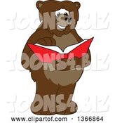 Vector Illustration of a Cartoon Grizzly Bear School Mascot Reading a Book by Toons4Biz