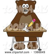 Vector Illustration of a Cartoon Grizzly Bear School Mascot Writing at a Desk by Toons4Biz