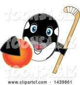 Vector Illustration of a Cartoon Killer Whale Orca Mascot Grabbing a Field Hockey Ball and Holding a Stick by Toons4Biz