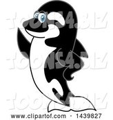 Vector Illustration of a Cartoon Killer Whale Orca Mascot Presenting or Waving by Toons4Biz