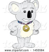 Vector Illustration of a Cartoon Koala Bear Mascot Champion Wearing a Medal by Toons4Biz