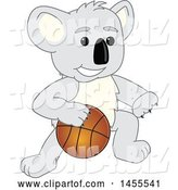 Vector Illustration of a Cartoon Koala Bear Mascot Dribbling a Basketball by Toons4Biz