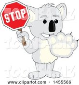 Vector Illustration of a Cartoon Koala Bear Mascot Gesturing Stop and Holding a Sign by Toons4Biz