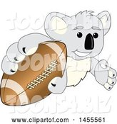 Vector Illustration of a Cartoon Koala Bear Mascot Grabbing a Football by Toons4Biz