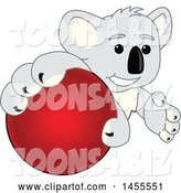 Vector Illustration of a Cartoon Koala Bear Mascot Grabbing a Red Ball by Toons4Biz