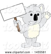 Vector Illustration of a Cartoon Koala Bear Mascot Holding a Blank Sign by Toons4Biz