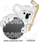 Vector Illustration of a Cartoon Koala Bear Mascot Holding a Hockey Stick and Grabbing a Puck by Toons4Biz