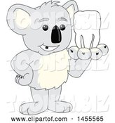 Vector Illustration of a Cartoon Koala Bear Mascot Holding a Tooth by Toons4Biz