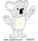 Vector Illustration of a Cartoon Koala Bear Mascot Holding up a Finger by Toons4Biz
