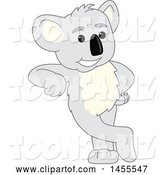 Vector Illustration of a Cartoon Koala Bear Mascot Leaning by Toons4Biz