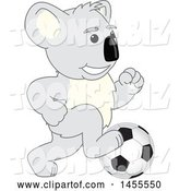 Vector Illustration of a Cartoon Koala Bear Mascot Playing Soccer by Toons4Biz