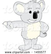Vector Illustration of a Cartoon Koala Bear Mascot Pointing by Toons4Biz