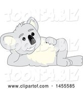 Vector Illustration of a Cartoon Koala Bear Mascot Resting on His Side by Toons4Biz
