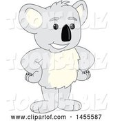 Vector Illustration of a Cartoon Koala Bear Mascot Standing with Hands on Hips by Toons4Biz