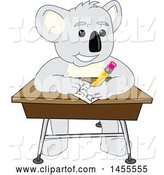 Vector Illustration of a Cartoon Koala Bear Mascot Student Writing at a Desk by Toons4Biz