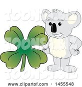 Vector Illustration of a Cartoon Koala Bear Mascot with a St Patricks Day Four Leaf Clover by Toons4Biz