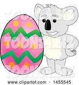 Vector Illustration of a Cartoon Koala Bear Mascot with an Easter Egg by Toons4Biz