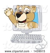 Vector Illustration of a Cartoon Lion Cub School Mascot Emerging from a Computer Screen by Toons4Biz