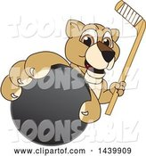Vector Illustration of a Cartoon Lion Cub School Mascot Grabbing a Hockey Puck and Holding a Stick by Toons4Biz