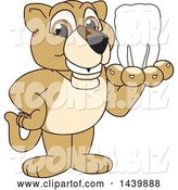 Vector Illustration of a Cartoon Lion Cub School Mascot Holding a Tooth by Toons4Biz