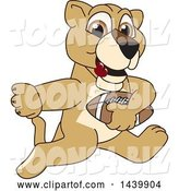 Vector Illustration of a Cartoon Lion Cub School Mascot Playing Football by Toons4Biz