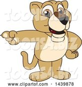 Vector Illustration of a Cartoon Lion Cub School Mascot Pointing by Toons4Biz