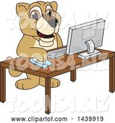 Vector Illustration of a Cartoon Lion Cub School Mascot Using a Computer by Toons4Biz