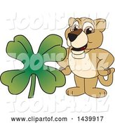 Vector Illustration of a Cartoon Lion Cub School Mascot with a St Patricks Day Clover by Toons4Biz