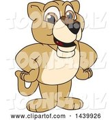 Vector Illustration of a Cartoon Lion Cub School Mascot with His Hands on His Hips by Toons4Biz