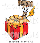 Vector Illustration of a Cartoon Mallet Mascot Standing by a Christmas Present by Toons4Biz