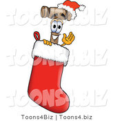 Vector Illustration of a Cartoon Mallet Mascot Wearing a Santa Hat Inside a Red Christmas Stocking by Toons4Biz