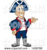 Vector Illustration of a Cartoon Patriot Mascot Pointing by Toons4Biz
